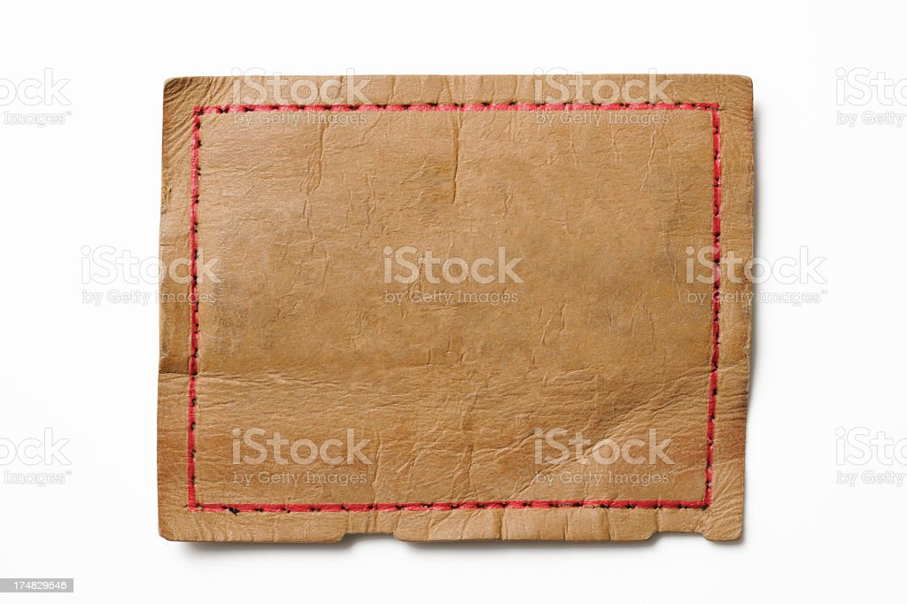 Isolated shot of blank old jeans label on white background royalty-free stock photo