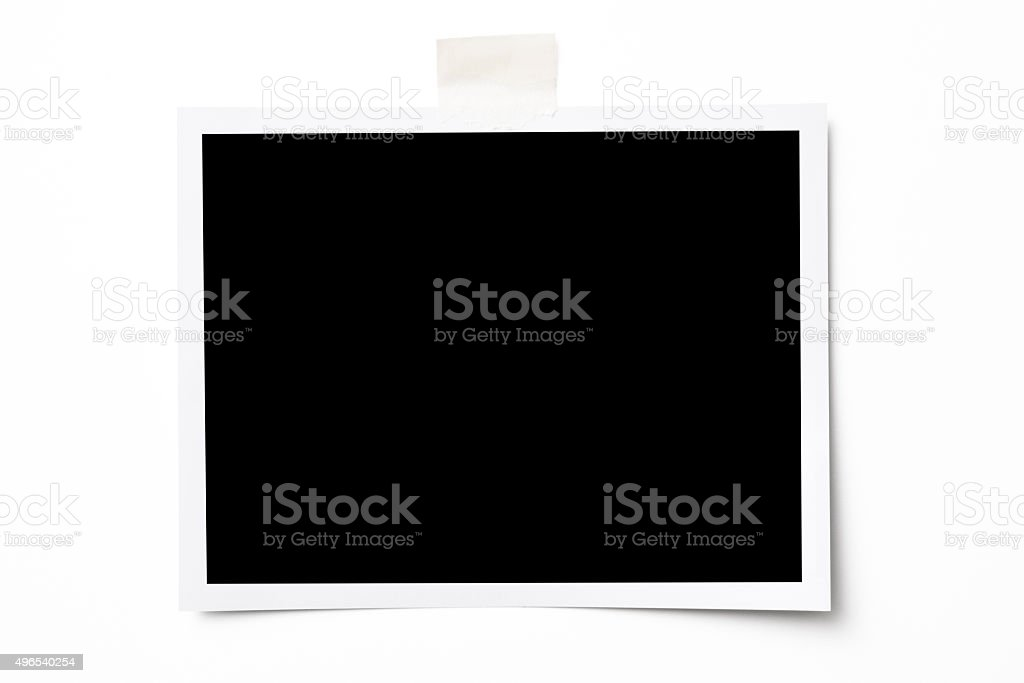 Isolated shot of blank photo with tape on white background stock photo