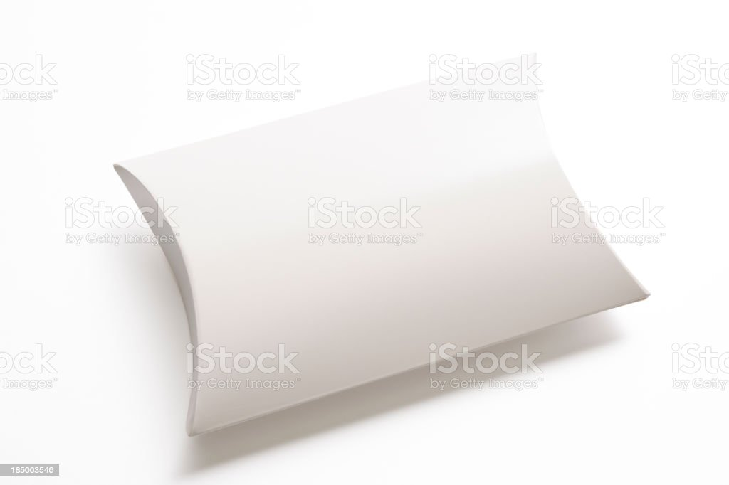 Isolated shot of blank pillow shape box on white background stock photo