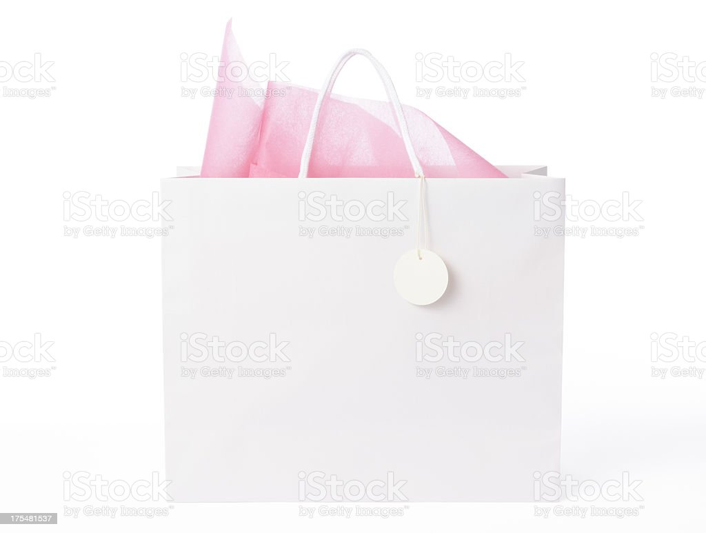 Isolated shot of  blank shopping bag with tag on white stock photo