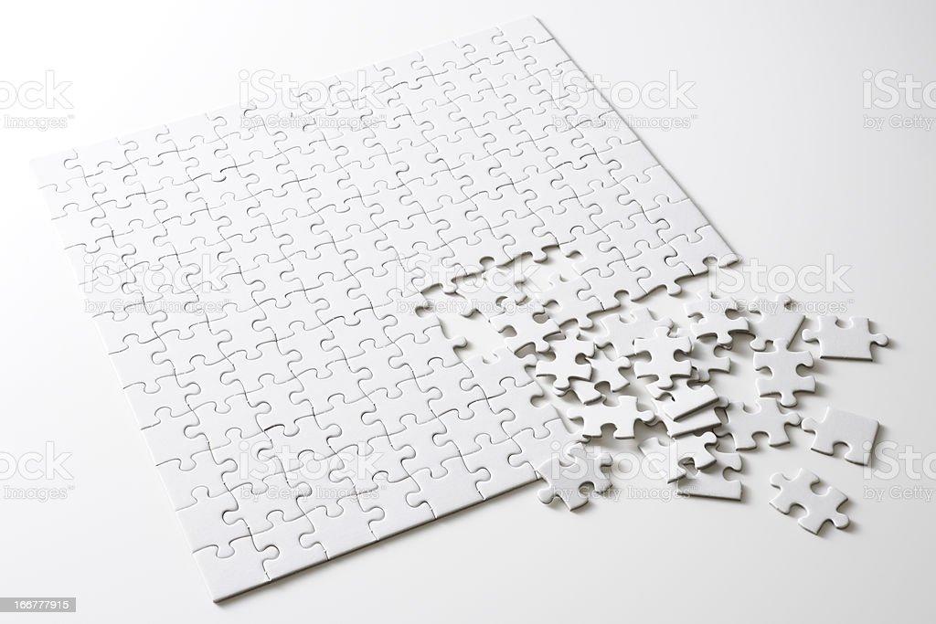 Isolated shot of blank square jigsaw puzzle on white background stock photo