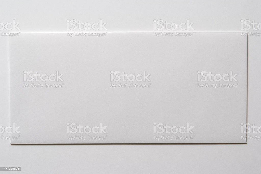 Isolated shot of blank white envelope on white background stock photo