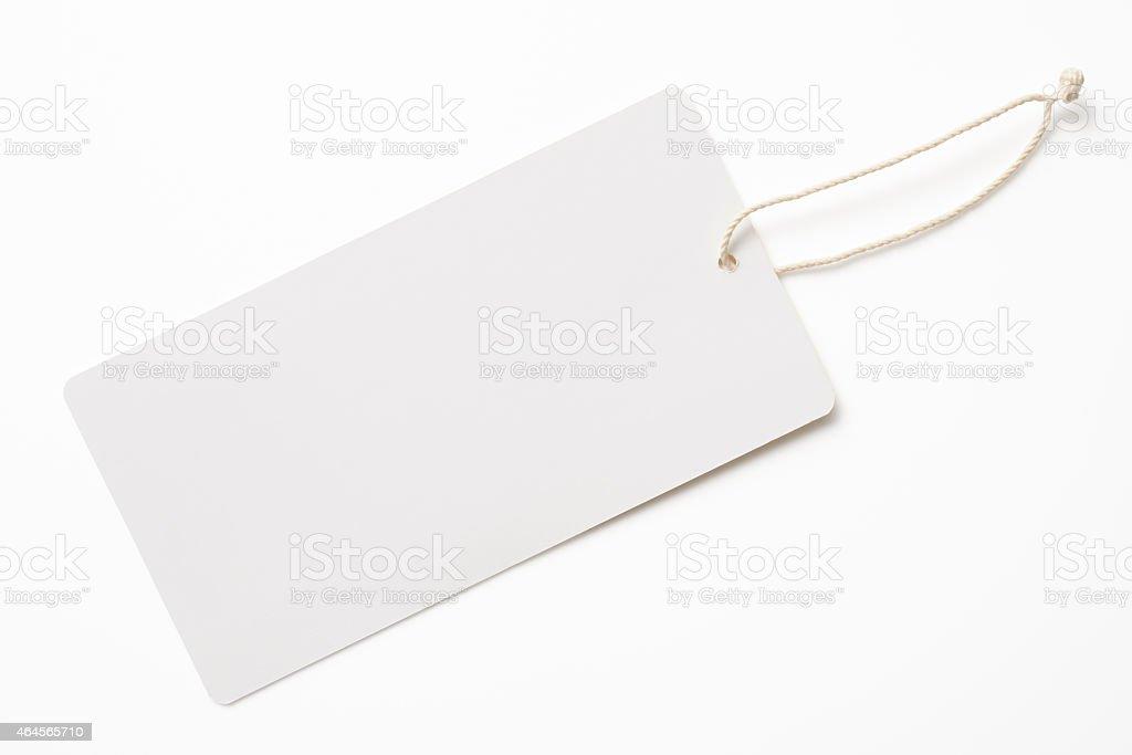 Isolated shot of blank white tag on white background stock photo