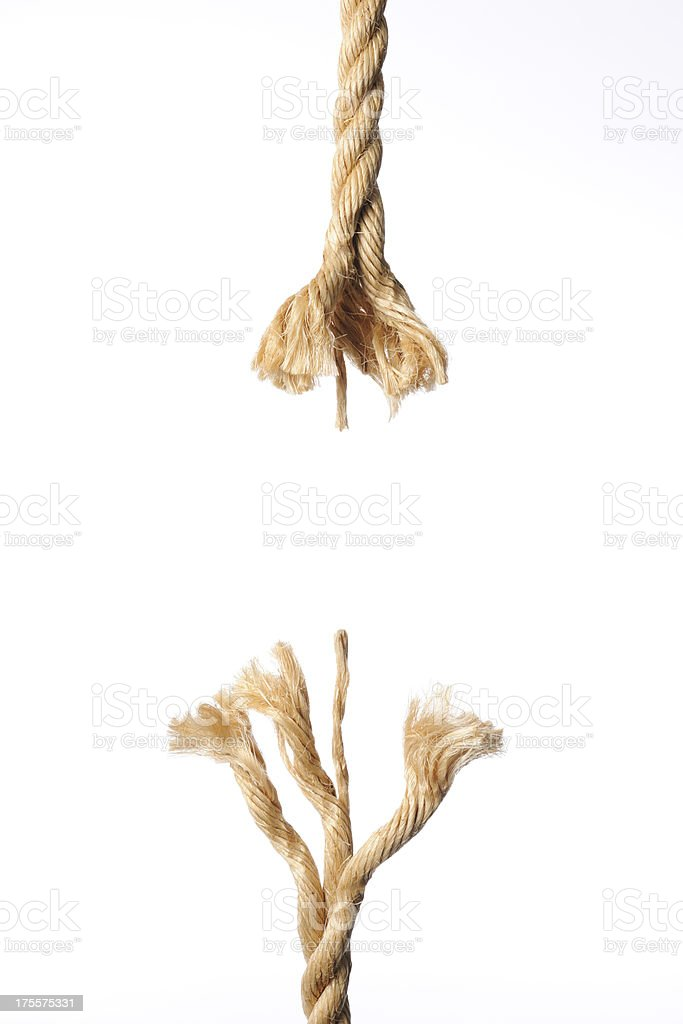 Isolated shot of breaking brown rope against white background stock photo