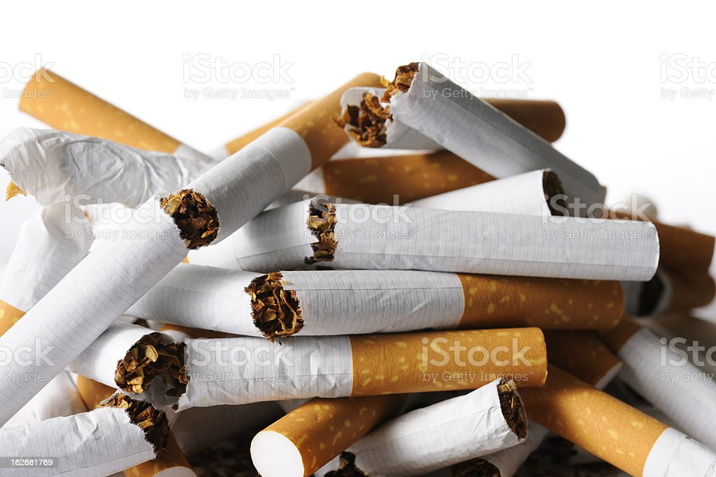 Isolated shot of broken new cigarettes on white background stock photo