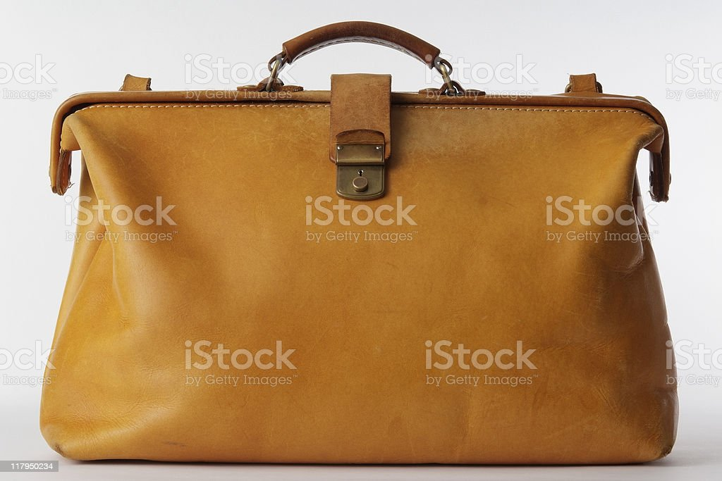 Isolated shot of brown leather bag on white background stock photo