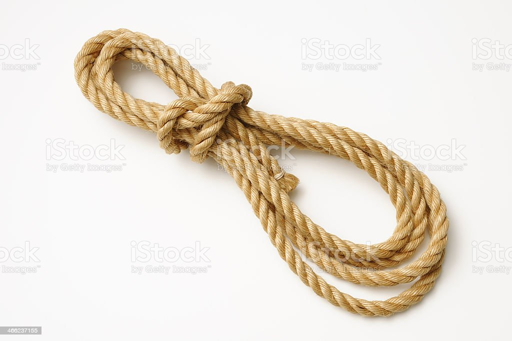 Isolated shot of brown rope on white background with shadow stock photo