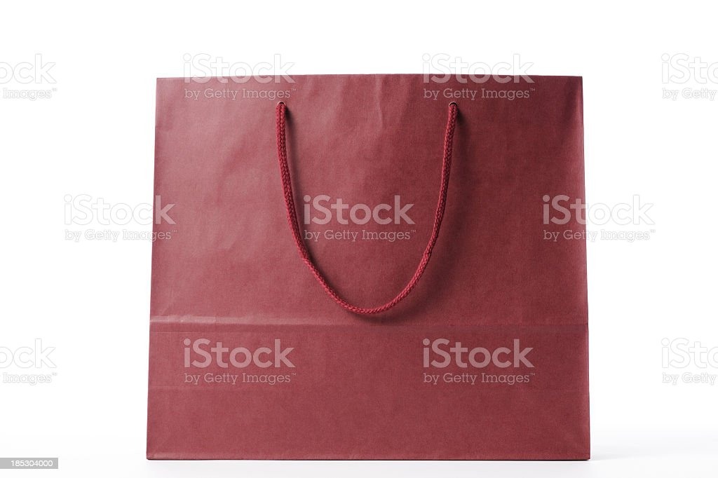 Isolated shot of brown shopping bag on white background royalty-free stock photo