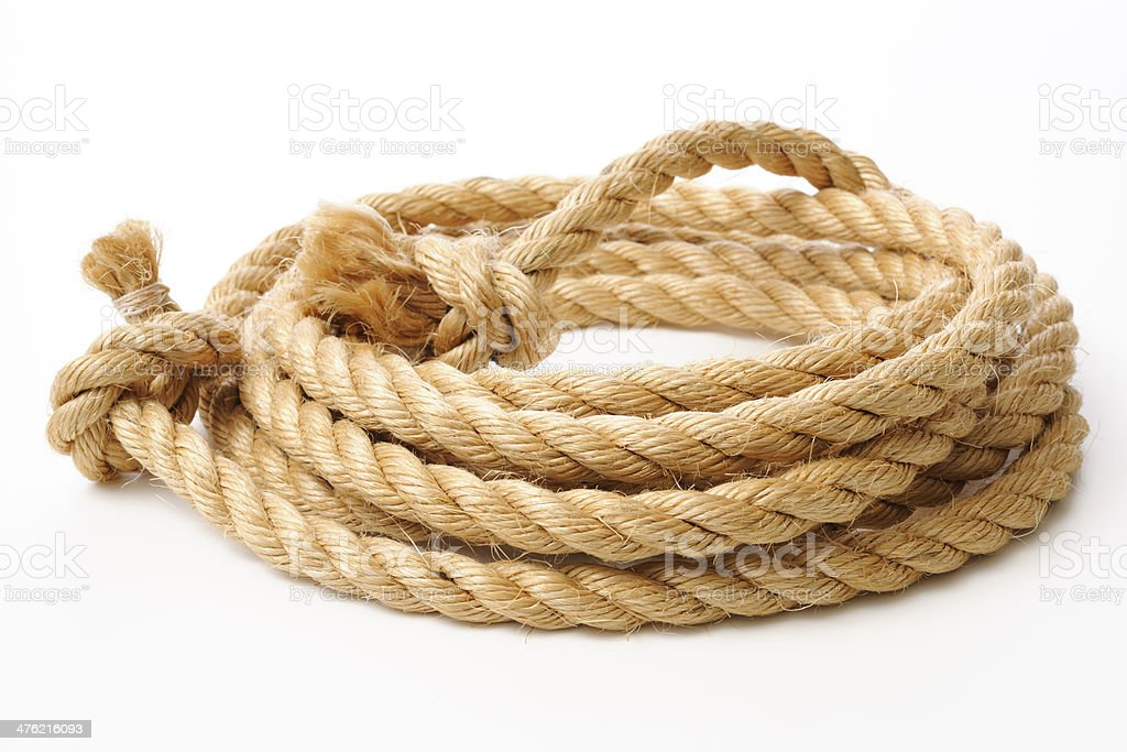 Isolated shot of brown spiral rope on white background stock photo