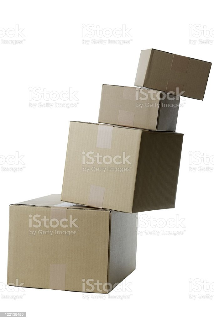 Isolated shot of cardboard boxes falls down on white background royalty-free stock photo