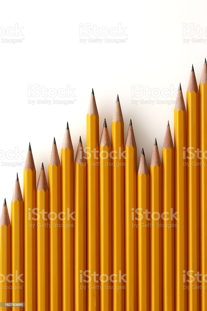 Isolated shot of chart from yellow pencils on white background royalty-free stock photo