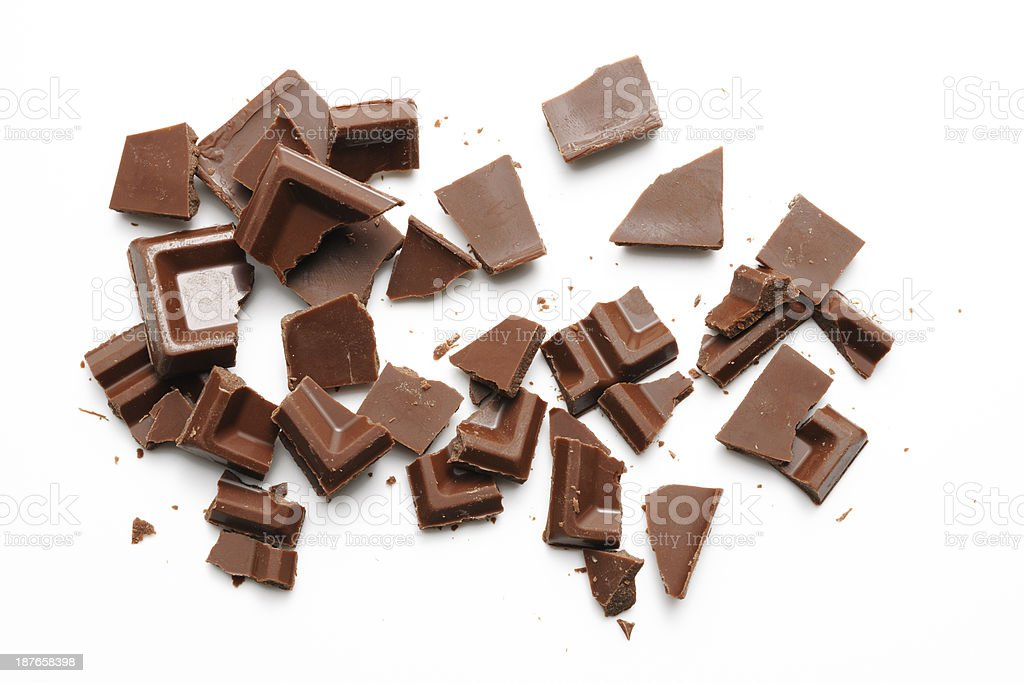 Isolated shot of Chocolate pieces on white background stock photo