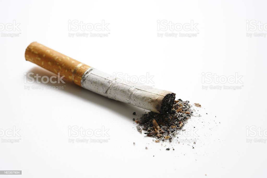 Isolated shot of cigarette butt on white background royalty-free stock photo