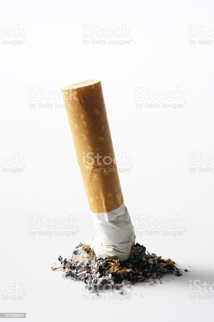 Isolated shot of cigarette butt on white background stock photo