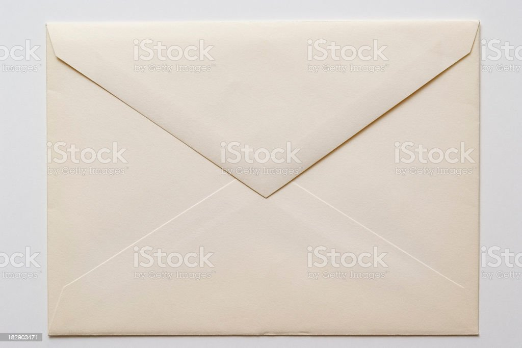 Isolated shot of closed an old envelope on white background stock photo