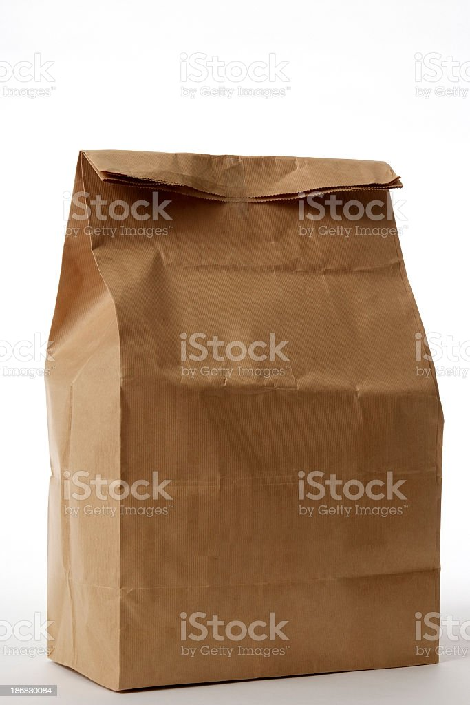 Isolated shot of closed brown paper bag on white background royalty-free stock photo