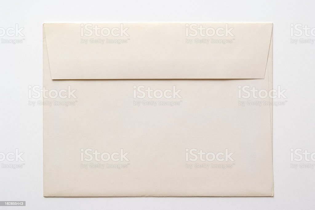 Isolated shot of closed old white envelope on white background royalty-free stock photo