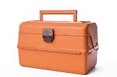Isolated shot of closed orange tackle box on white background