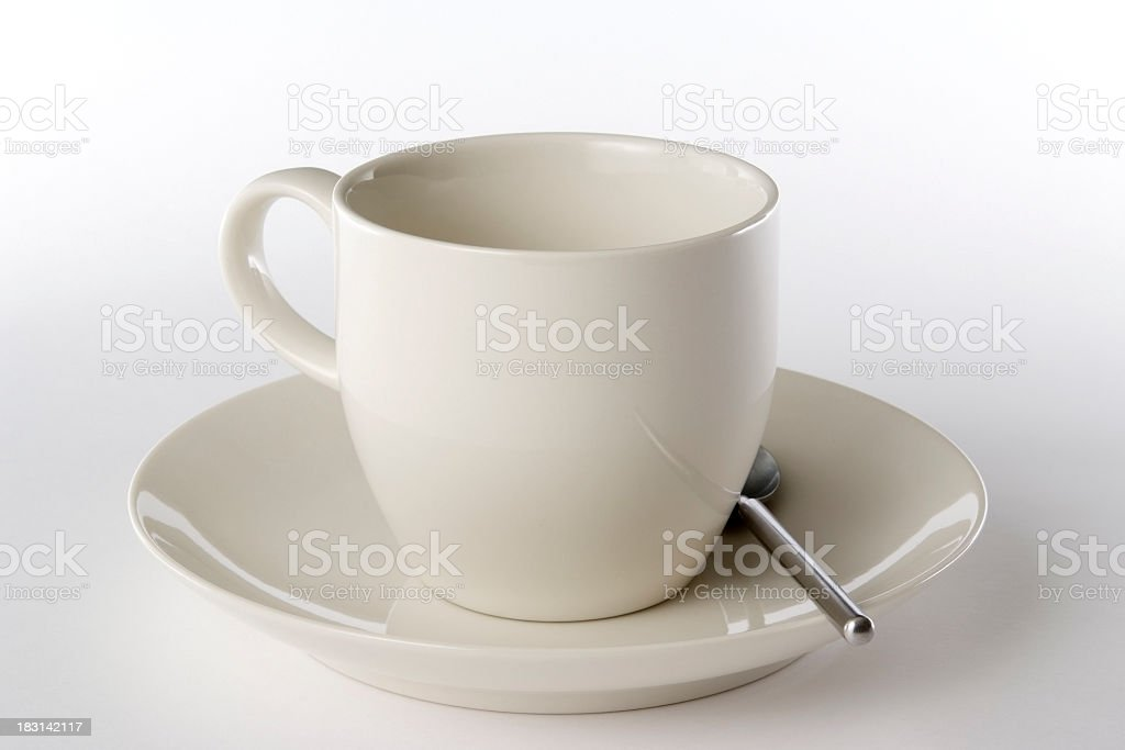 Isolated shot of coffee cup with spoon on white background royalty-free stock photo