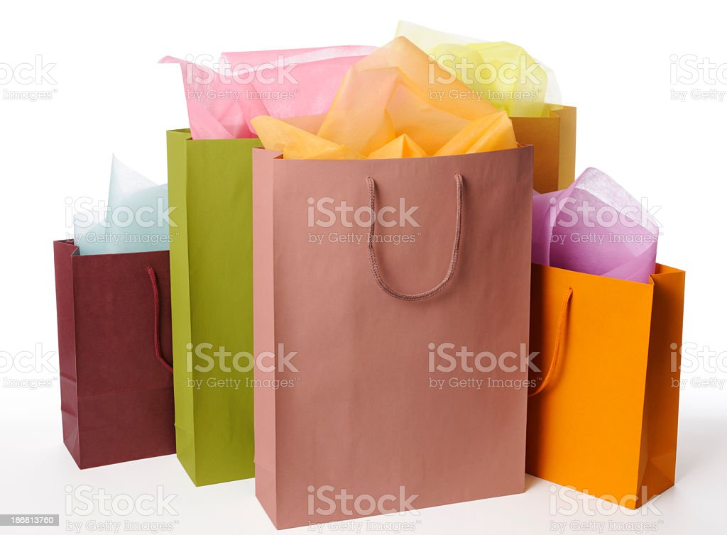Isolated shot of colorful shopping bags on white background stock photo