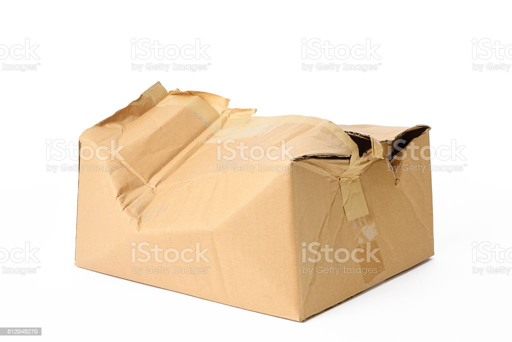 Isolated shot of crushed cardboard box on white background stock photo