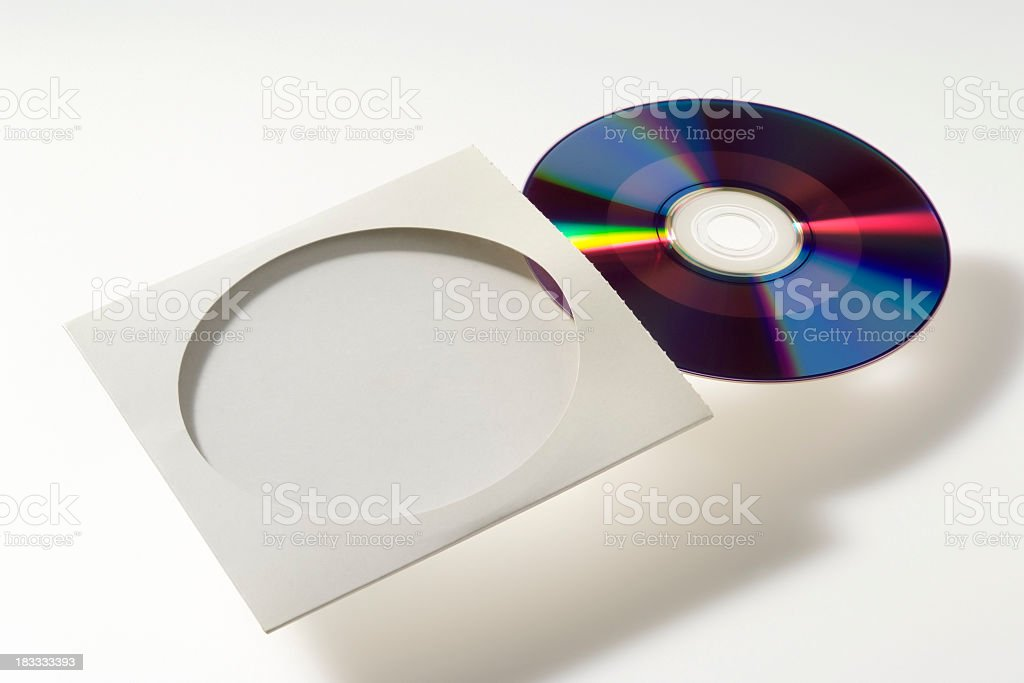 Isolated shot of DVD with paper case on white background royalty-free stock photo
