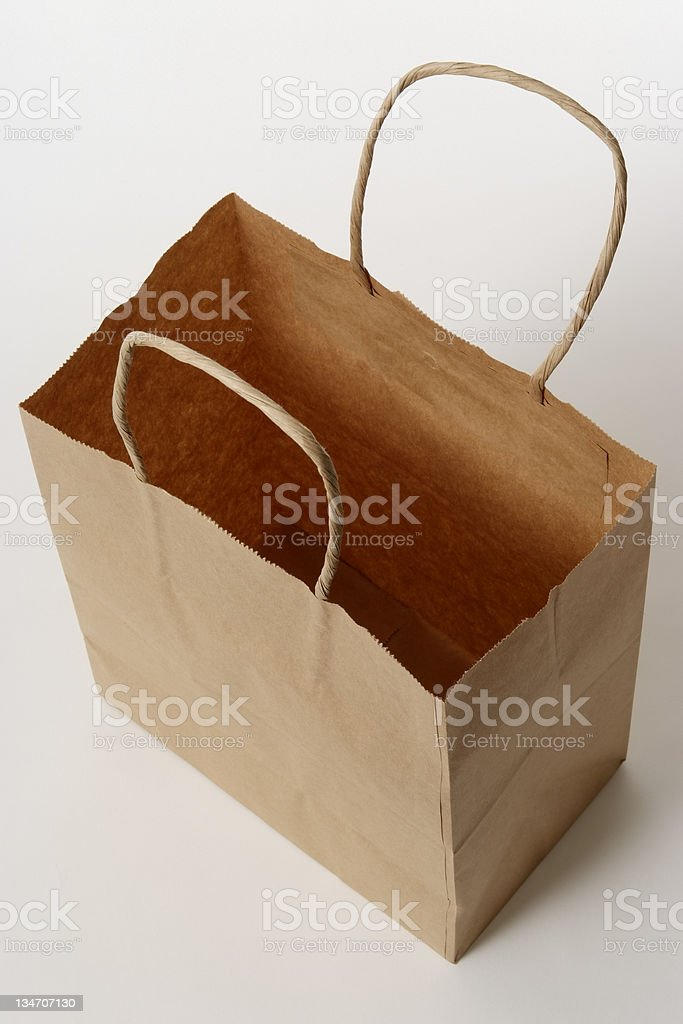 Isolated shot of empty brown shopping bag on white background royalty-free stock photo