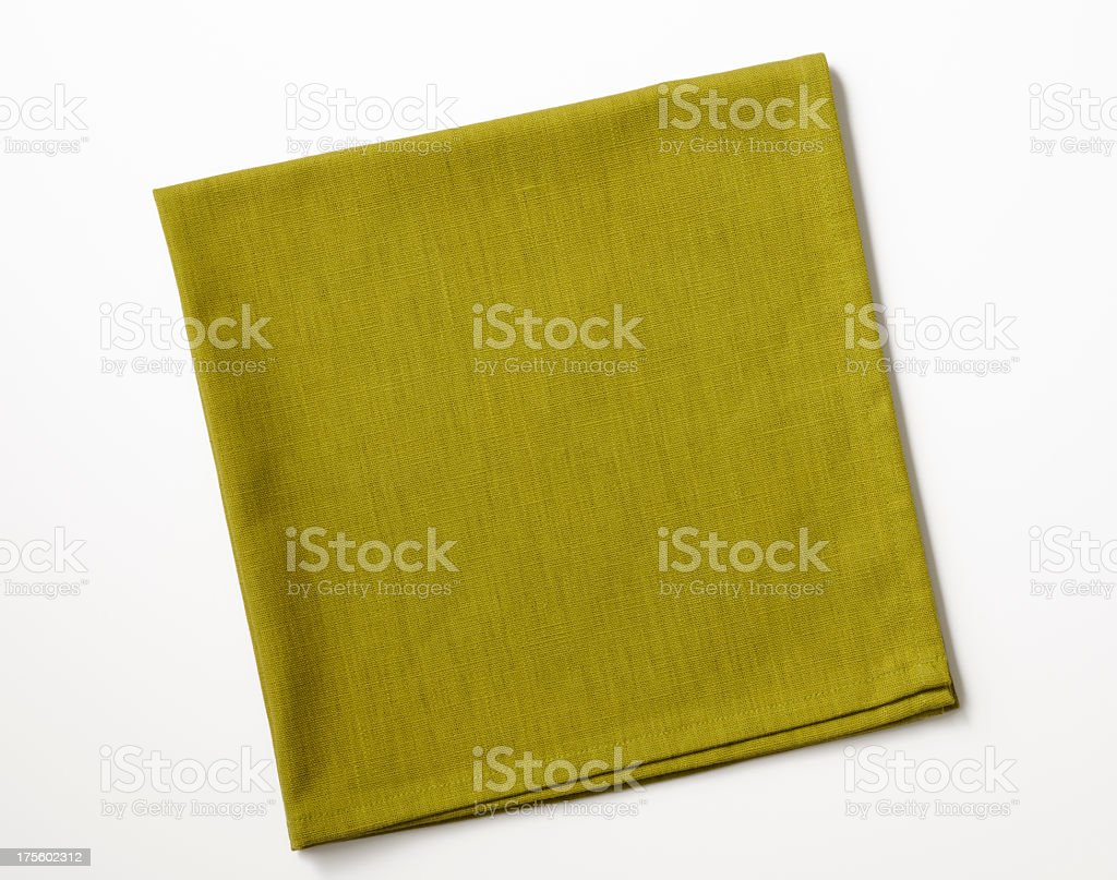 Isolated shot of folded green napkin on white background stock photo