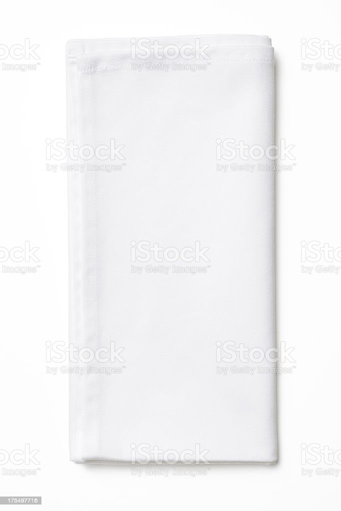 Isolated shot of folded white napkin on white background stock photo