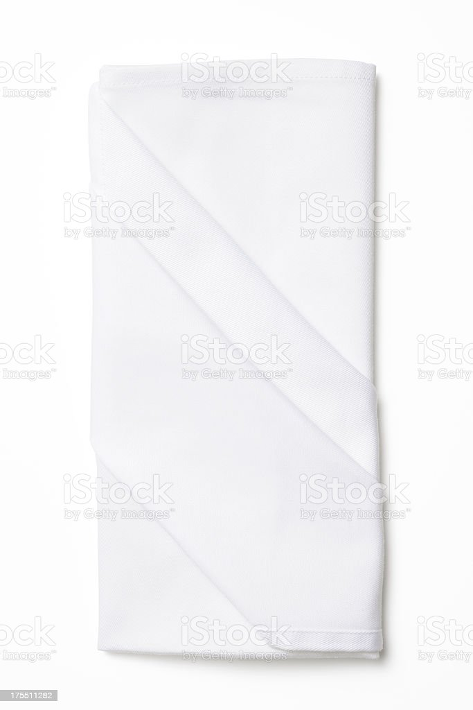Isolated shot of folded white napkin on white background stock photo