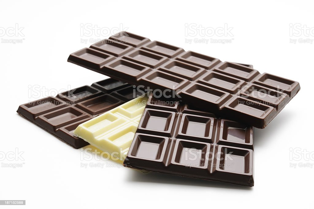 Isolated shot of four different chocolate bars on white background royalty-free stock photo
