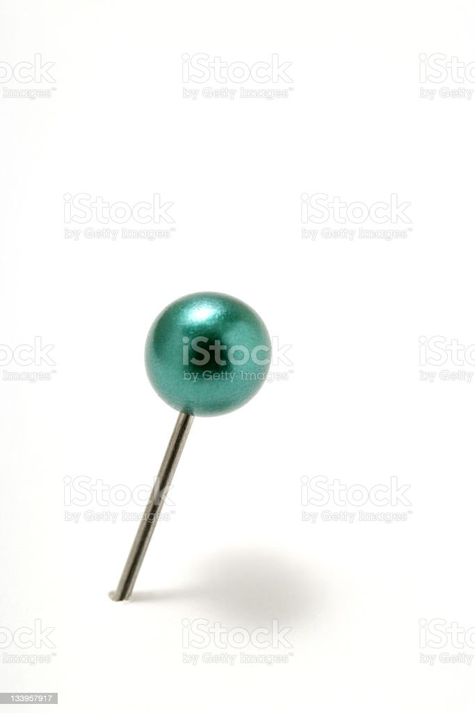 Isolated shot of green pushpin on white background royalty-free stock photo