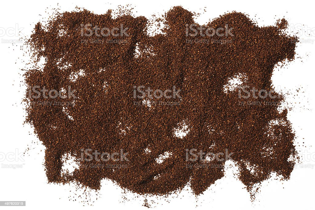 Isolated shot of ground coffee beans texture on white background royalty-free stock photo
