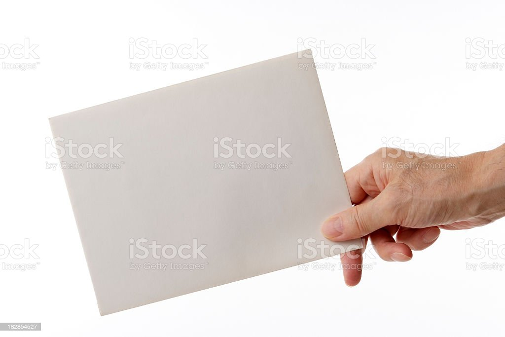 Isolated shot of holding a blank envelope against white background stock photo