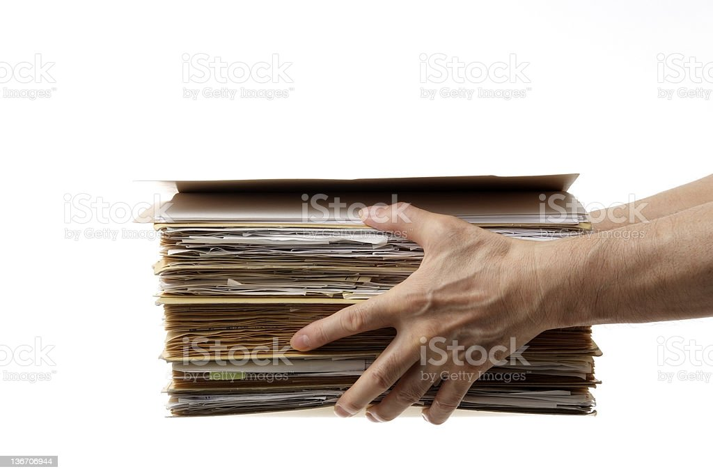 Isolated shot of holding a stacked documents against white background royalty-free stock photo
