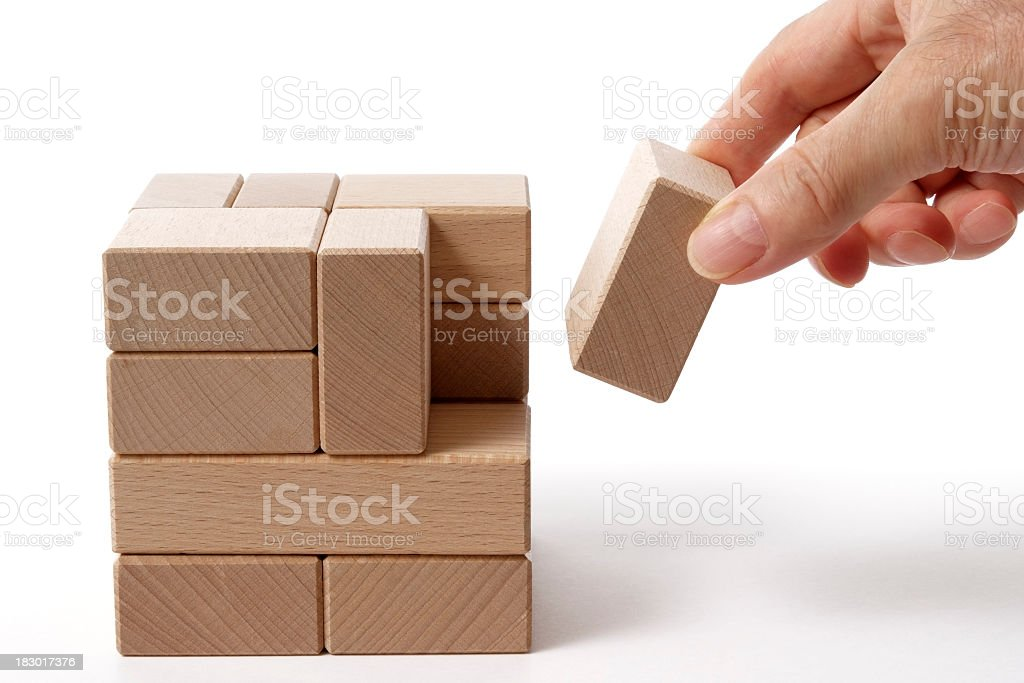 Isolated shot of holding a wood block on white background royalty-free stock photo