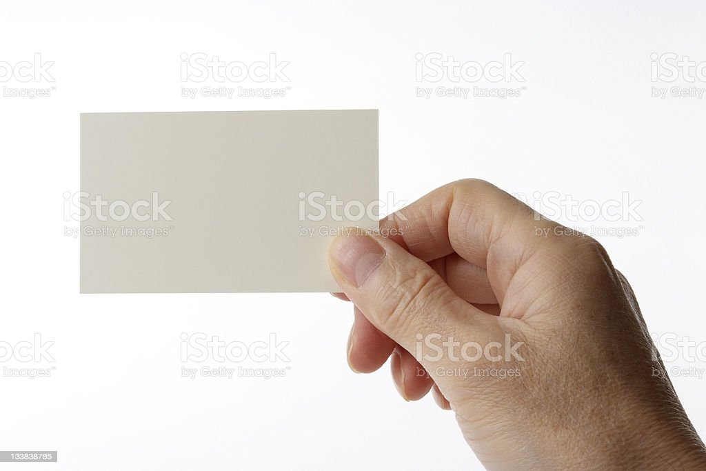 Isolated shot of holding blank business card against white background royalty-free stock photo