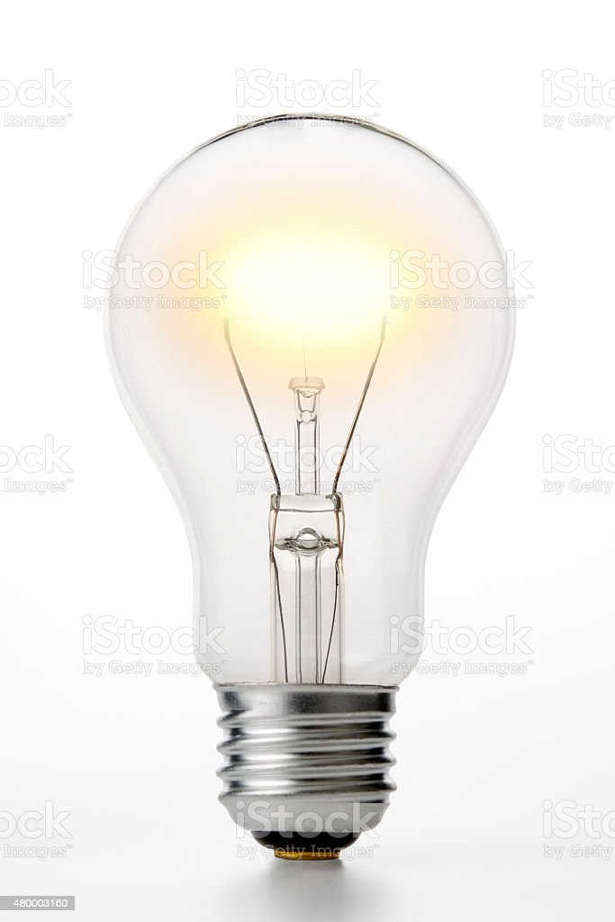 Isolated shot of illuminated light bulb on white background stock photo