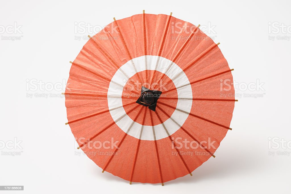 Isolated shot of Japanese miniature red umbrella on white background stock photo