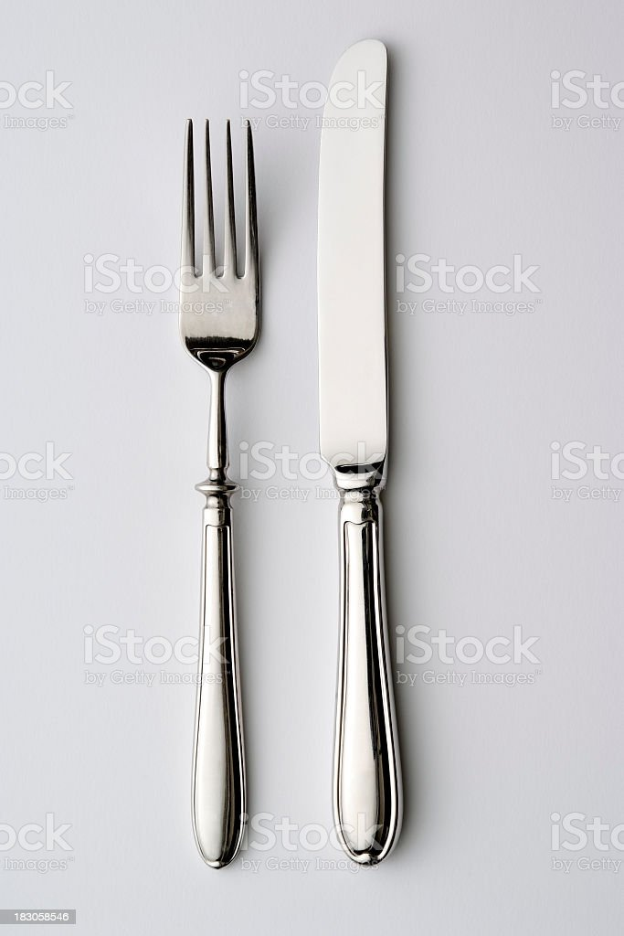 Isolated shot of knife and fork on white background stock photo