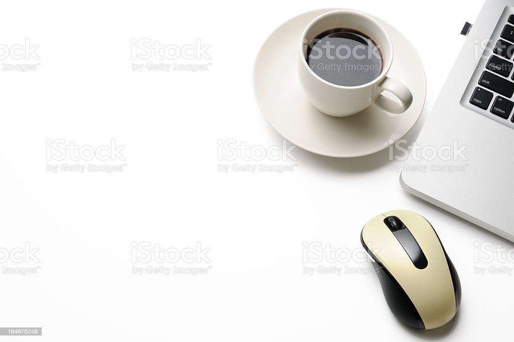 Isolated shot of laptop with a coffee on white background stock photo