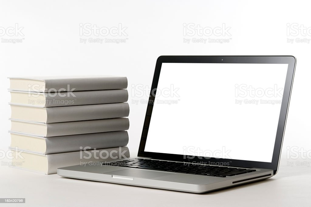 Isolated shot of laptop with blank books on white background royalty-free stock photo
