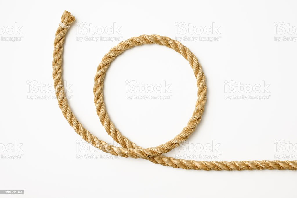 Isolated shot of loop of brown rope on white background stock photo