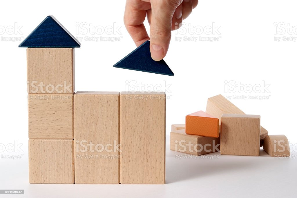 Isolated shot of making a block house on white background royalty-free stock photo
