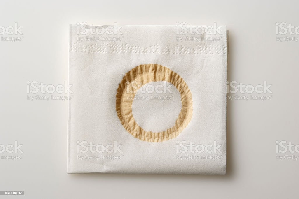 Isolated shot of napkin with coffee stain on white background stock photo