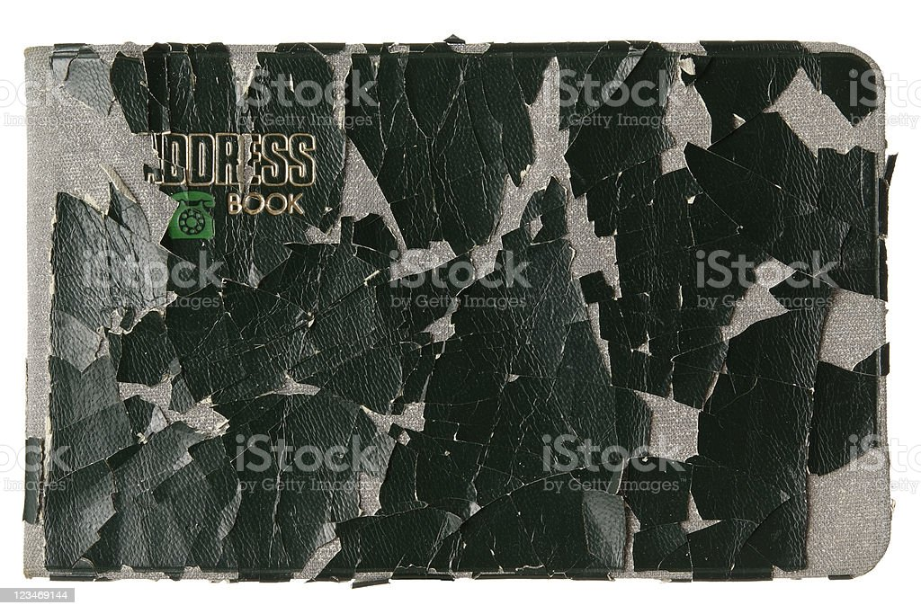Isolated shot of old address book on white background stock photo