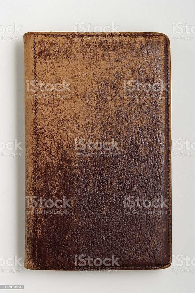 Isolated shot of old brown leather diary on white background stock photo