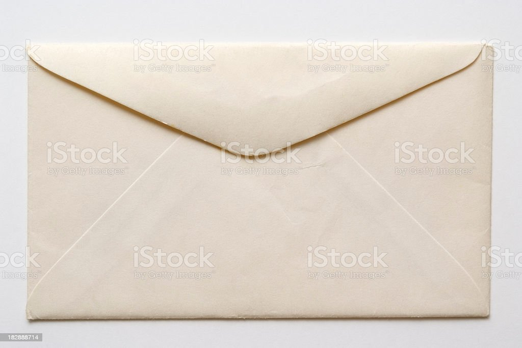 Isolated shot of old envelope on white background stock photo