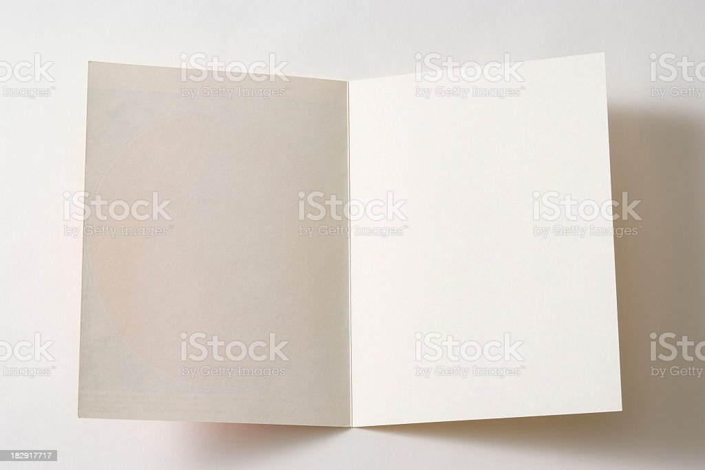 Isolated shot of opened antique blank paper on white background royalty-free stock photo