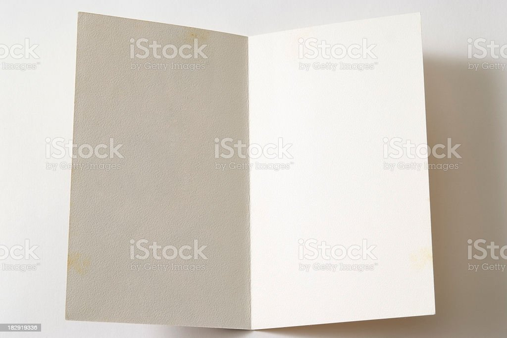 Isolated shot of opened antique blank paper on white background stock photo